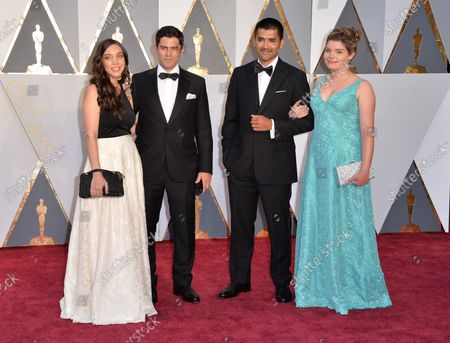 Chileans Gabriel Osorio and Pato Escala and their guests, nominated for Best Animated Short, arrive on the red carpet during the 88th Academy Awards, at the Hollywood and Highland Center in the Hollywood section of Los Angeles on February 28, 2016.