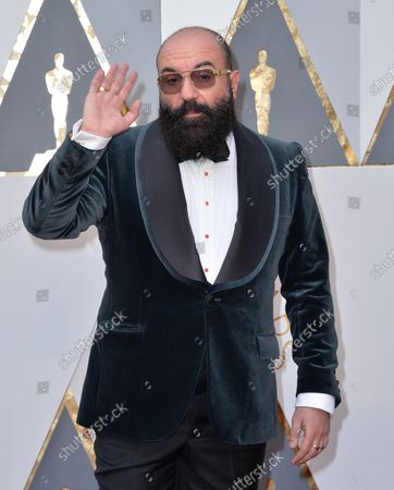 Paco Delgado arrives on the red carpet for the 88th Academy Awards at the Hollywood and Highland Center in the Hollywood section of Los Angeles on February 28, 2016.