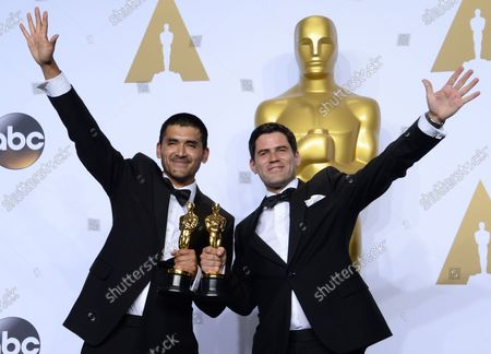 Stock Image of Gabriel Osorio, left, and Pato Escala, winners for Best Animated Short Film for 'Bear Story,'  appear backstage at the 88th Academy Awards, at the Hollywood and Highland Center in the Hollywood section of Los Angeles on February 28, 2016.