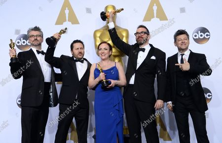 Actor Andy Serkis, right, and visual effects artists Mark Ardington, Paul Norris, Sara Bennett and Andrew Whitehurst, winners of the Best Visual Effects award for 'Ex Machina,' appear backstage at the 88th Academy Awards, at the Hollywood and Highland Center in the Hollywood section of Los Angeles on February 28, 2016.