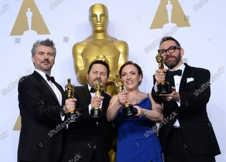 Stock Photo of Visual effects artists Mark Ardington, Paul Norris, Sara Bennett and Andrew Whitehurst, winners of the Best Visual Effects award for 'Ex Machina,' appear backstage at the 88th Academy Awards, at the Hollywood and Highland Center in the Hollywood section of Los Angeles on February 28, 2016.