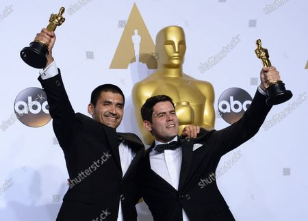 Stock Picture of Gabriel Osorio, left, and Pato Escala, winners for Best Animated Short Film for 'Bear Story,'  appear backstage at the 88th Academy Awards, at the Hollywood and Highland Center in the Hollywood section of Los Angeles on February 28, 2016.