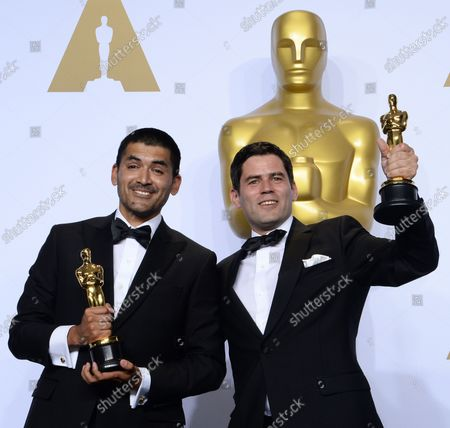 Gabriel Osorio, left, and Pato Escala, winners for Best Animated Short Film for 'Bear Story,'  appear backstage at the 88th Academy Awards, at the Hollywood and Highland Center in the Hollywood section of Los Angeles on February 28, 2016.