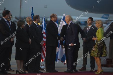 US Vice President Joe Biden shakes hands with Israel Defense Minister Moshe Ya'alon (L) after arriving at Ben-Gurion Airport in Lod, Israel on March 8, 2016. Biden will be meeting with Israeli leaders and also Palestinian officials including Palestinian President Mahmoud Abbas during his two day visit to the region.