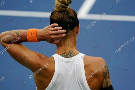 Polona Hercog, of Slovenia, pauses during her first-round match at the US Open tennis championships, in New York
