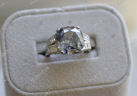 Stock Picture of The Shirley Temple Blue Diamond is on display before its auction at Sotheby's in New York City on March 18, 2016. The Shirley Temple Blue Diamond is a 9.54-Carat Fancy Deep Blue Diamond Ring Worn by American Hollywood child star Shirley Temple and is estimated to sell for $25-$35 million dollars. Temple's father purchased the diamond ring in early 1940 for $7,210 at around the time of her 12th birthday.
