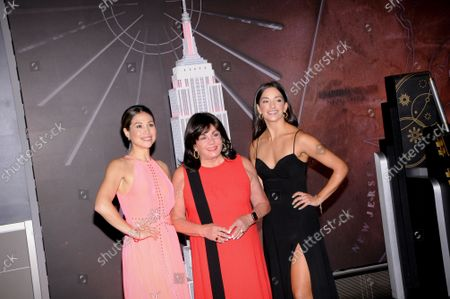 (L-R) Bianca Marroquin, Charlotte St. Martin and Ana Villafane visit the Empire State Building to celebrate Broadway's reopening, in New York City.