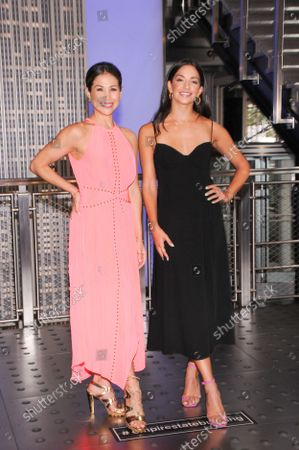 (L-R) Actresses Bianca Marroquin and Ana Villafane visit the Empire State Building to celebrate Broadway's reopening, in New York City.