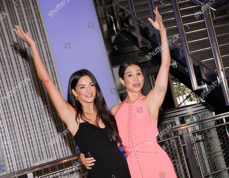 Stock Picture of (L-R) Actresses Ana Villafane and Bianca Marroquin visit the Empire State Building to celebrate Broadway's reopening, in New York City.