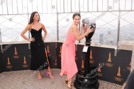(L-R) Actresses Ana Villafane and Bianca Marroquin visit the Empire State Building to celebrate Broadway's reopening, in New York City.