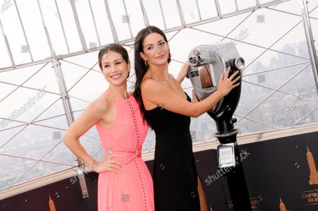Stock Image of (L-R) Actresses Bianca Marroquin and Ana Villafane visit the Empire State Building to celebrate Broadway's reopening, in New York City.