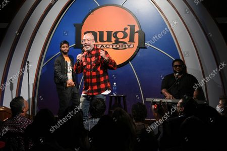 """King Bach, from left, Jo Koy, and Craig Robinson perform during """"Stand Up for Haiti"""" comedy fundraiser, at The Laugh Factory in Los Angeles"""