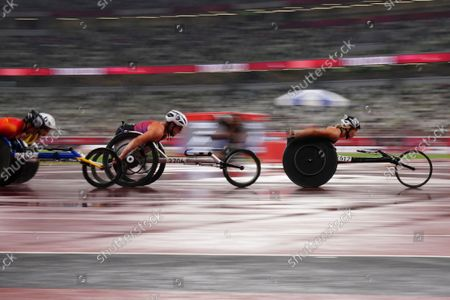 Manuela Schaer of Switzerland, right, and Tatyana McFadden of the United States, second from right, compete in the women's 1500m T54 final during the Tokyo 2020 Paralympics Games at the National Stadium in Tokyo, Japan