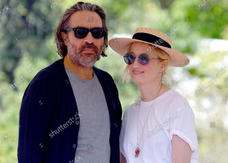 Saverio Costanzo (L) and Italian actress Alba Rohrwacher (R) arrive at Lido Beach ahead of the 78th annual Venice International Film Festival, in Venice, Italy, 31 August 2021. The 78th Venice Film Festival runs from 01 to 11 September 2021.