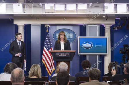 """Actress Allison Janney, who played press secretary C. J. Cregg on """"The West Wing"""", makes a guest appearance at the White House Daily Briefing to bring attention on opioid drug epidemic, as White House Press Secretary Jay Carney watches, at the White House in Washington, D.C. on April 29, 2016."""