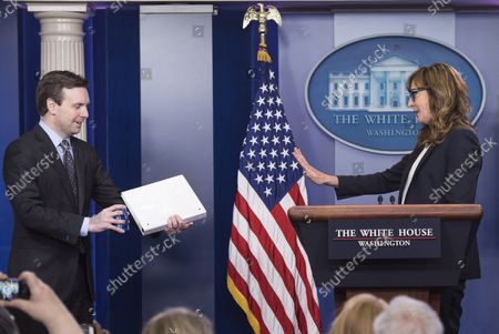 """White House Press Secretary Jay Carney (L) jokes with Actress Allison Janney, who played press secretary C. J. Cregg on """"The West Wing"""", as she makes a guest appearance at the White House Daily Briefing to bring attention on opioid drug epidemic, at the White House in Washington, D.C. on April 29, 2016."""