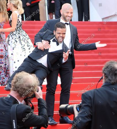 """Stock Picture of Franck Gastambide (R) and Anouar Toubali arrive on the steps of the Palais des Festival before the screening of the film """"Money Monster"""" at the opening of the 69th annual Cannes International Film Festival in Cannes, France on May 12, 2016."""