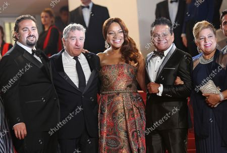 """(From L to R) Jonathan Jakubowicz, Robert De Niro, Grace Hightower, Roberto Duran and Felicidad Duran arrive on the steps of the Palais des Festivals before the screening of the film """"Hands of Stone"""" during the 69th annual Cannes International Film Festival in Cannes, France on May 16, 2016."""