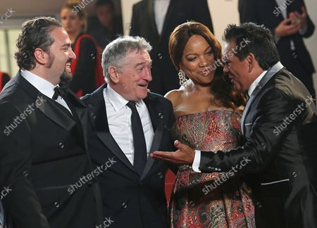 """(From L to R) Jonathan Jakubowicz, Robert De Niro, Grace Hightower and Roberto Duran arrive on the steps of the Palais des Festivals before the screening of the film """"Hands of Stone"""" during the 69th annual Cannes International Film Festival in Cannes, France on May 16, 2016."""