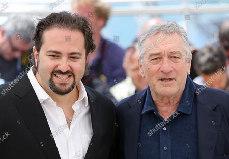 """Jonathan Jakubowicz (L) and Robert De Niro arrive at a photocall for the film """"Hands of Stone"""" during the 69th annual Cannes International Film Festival in Cannes, France on May 16, 2016."""