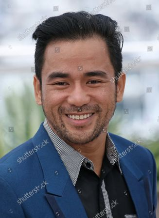"""Stock Image of Neil Ryan Sese arrives at a photocall for the film """"Ma'Rosa"""" during the 69th annual Cannes International Film Festival in Cannes, France on May 18, 2016."""