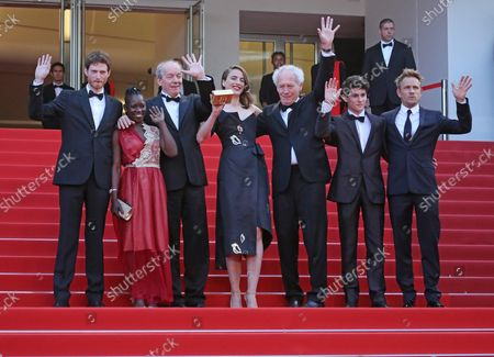 """Olivier Bonnaud, Nadege Ouedraogo, Luc Dardenne, Adele Haenel, Jean-Pierre Dardenne, Louka Minnella and Jeremie Renier arrive on the steps of the Palais des Festivals before the screening of the film """"La Fille Inconnue (The Unknown Girl)"""" during the 69th annual Cannes International Film Festival in Cannes, France on May 18, 2016."""