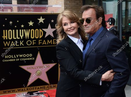 Actress Deidre Hall (L) is joined by actor Thaao Penghlis during an unveiling ceremony honoring her with the 2,581st star on the Hollywood Walk of Fame in Los Angeles on May 19, 2016.
