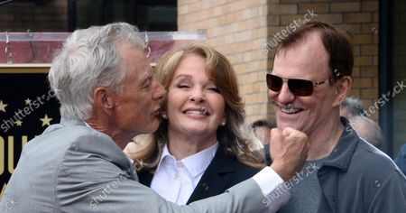 Stock Photo of Actress Deidre Hall (C) is joined by actors Wayne Northrop (L), and Josh Taylor during an unveiling ceremony honoring her with the 2,581st star on the Hollywood Walk of Fame in Los Angeles on May 19, 2016.