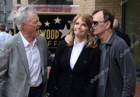 Stock Image of Actress Deidre Hall (C) is joined by actors Wayne Northrop (L), and Josh Taylor during an unveiling ceremony honoring her with the 2,581st star on the Hollywood Walk of Fame in Los Angeles on May 19, 2016.