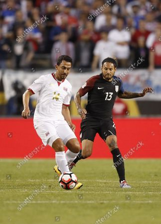 Costa Rica midfielder Randall Azofeifa (L) and United States midfielder Jermaine Jones go for the ball during the first half of a 2016 Copa America Centenario Group A match at Soldier Field in Chicago on June 7, 2016. The United States defeated Costa Rica 4-0.