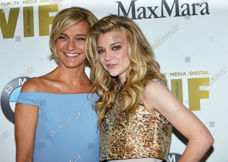 Natalie Dormer (R) and Nicola Maramotti arrive at the Women In Film 2016 Crystal + Lucy Awards at the Beverly Hilton in Beverly Hills, California on June 15, 2016.