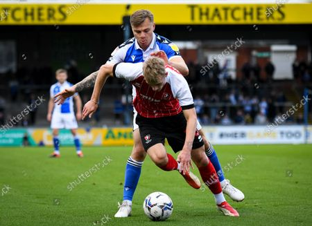 Harry Anderson of Bristol Rovers tackles Taylor Perry of Cheltenham Town