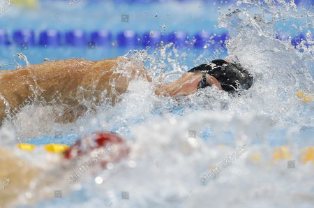 Conor Dwyer of the United States swims a leg of the Men's 4x200m freestyle relay at the Olympic Aquatics Stadium at the 2016 Rio Summer Olympics in Rio de Janeiro, Brazil, on August 9, 2016. The United States won the gold medal and Michael Phelps wins his 21st Gold Medal.