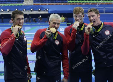 Michael Phelps of the United States celebrates with teammates Townley Haas, Conor Dwyer and Ryan Lochte after winning the gold medal in the Men's 4x200m freestyle relay at the Olympic Aquatics Stadium at the 2016 Rio Summer Olympics in Rio de Janeiro, Brazil, on August 9, 2016. The United States won the gold medal and Michael Phelps wins his 21st Gold Medal.