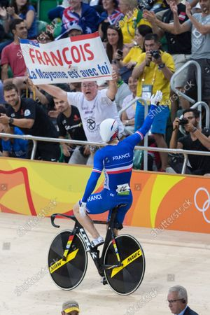 Michael D'Almeida of France celebrates a victory lap after winning the bronze medal in the Men's Team Sprint Finals at the Rio Olympic Velodrome during the 2016 Summer Olympics in Rio de Janeiro, Brazil, on August 11, 2016. France bested Australia for the bronze with a time of 43.143.