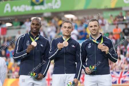 Cyclists Gregory Bauge, Michael D'Almeida and Francois Pervis of France show their Bronze medals following the presentation ceremony for the Men's Team Sprint Finals at the Rio Olympic Velodrome during the 2016 Summer Olympics in Rio de Janeiro, Brazil, on August 11, 2016. France won the bronze, New Zealand the silver and Great Britain the gold.