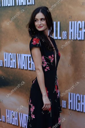 """Cast member Melanie Papalia attends the premiere of the motion picture crime drama """"Hell or High Water"""" at the ArcLight Cinema Dome in the Hollywood section of Los Angeles on August 10, 2016. Storyline: A divorced dad and his ex-con brother resort to a desperate scheme in order to save their family's farm in West Texas."""