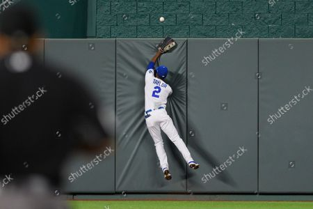 Kansas City Royals center fielder Michael A. Taylor can't catch a home run by Cleveland Indians' Amed Rosario during the seventh inning of a baseball game, in Kansas City, Mo