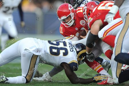 Los Angeles Rams' linebacker Akeem Ayers (56) tackles Kansas City Chiefs' quarterback Alex Smith (11) in first quarter action at the Los Angeles Coliseum in Los Angeles on August 20, 2016.