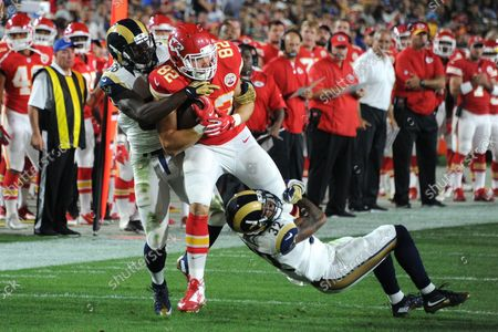 Los Angeles Rams' linebacker Akeem Ayers(56) and teammate Troy Hill (32) attempt to tackle Kansas City Chiefs' tight end Brian Parker (82)at the Los Angeles Coliseum in Los Angeles on August 20, 2016.