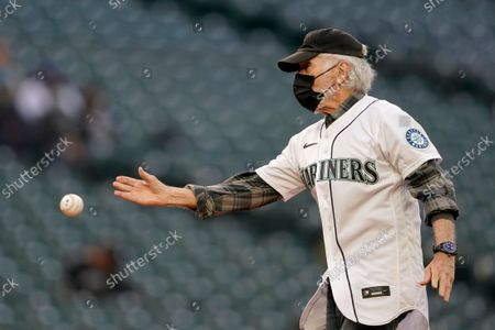 Stock Image of Actor Tom Skerritt throws out the first pitch before a baseball game between the Seattle Mariners and the Houston Astros, in Seattle