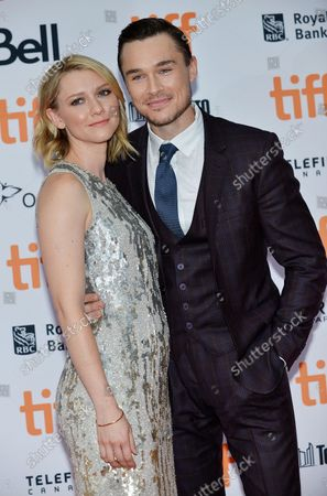 Valorie Curry (L) and Sam Underwood arrive at the world premiere of 'American Pastoral' at the Princess of Wales Theatre during the Toronto International Film Festival in Toronto, Canada on September 9, 2016.