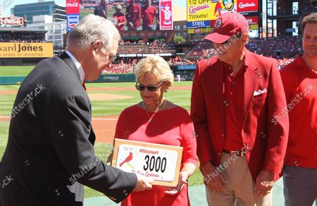 Missouri Governor Jay Nixon presents the Missouri Licence plate number 3000 to members of the Stan Musial family before a game between the Milwaukee Brewers and the St. Louis Cardinals at Busch Stadium in St. Louis on September 11, 2016.The licence plat, now offically retired, belonged to former Cardinals great and member of the National Hall of Fame member Stan Musial who died in January of 2013.