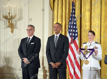 President Barack Obama awards the National Medal of Arts to playwright  Moises Kaufman during a ceremony at the White House in Washington, D.C. on September 22, 2016. Obama awarded the awarded the 2015 National Medal of Arts and National Humanities Medals to 24 recipients.