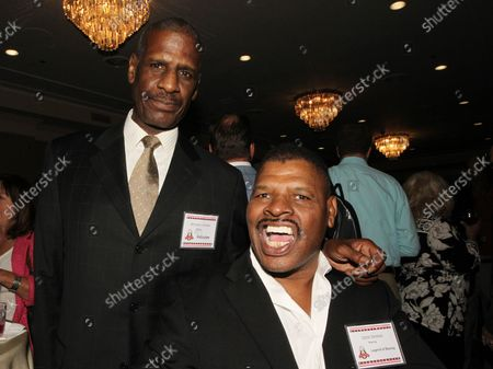 Former heavyweight boxing champions Leon Spinks and brother Michael Spinks arrive for the St. Louis Sports Hall of Fame Enshrinement ceremonies in Fronentec , Missouri on September 22, 2016.