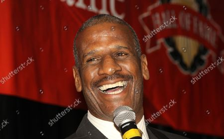 Former heavyweight boxing champion Michael Spinks has a laugh during the St. Louis Sports Hall of Fame Enshrinement ceremonies in Fronentec , Missouri on September 22, 2016.