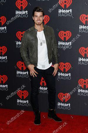 Reality Tv star Luke Pell arrives for the iHeartRadio Music Festival at the T-Mobile Arena in Las Vegas, Nevada on September 23, 2016.