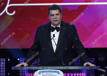 Mike Helton speaks on stage at the First Annual NASCAR Foundation Honors Gala at the Marriott Marquis on September 27, 2016 in New York City.