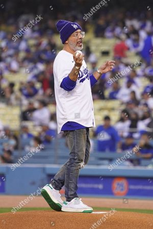 American stand-up comic Jo Koy throws out the first pitch before the MLB game between the Atlanta Braves and the Los Angeles Dodgers