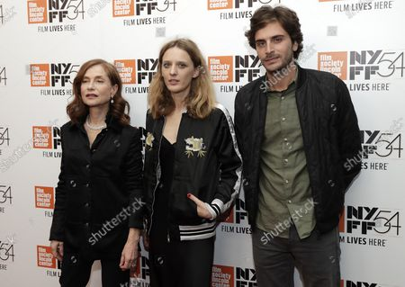 Mia Hansen-Love, Isabelle Huppert, and Roman Kolinka arrive on the red carpet at the 54th New York Film Festival -Things to Come/Elle at Alice Tully Hall, Lincoln Center on October 14, 2016 in New York City.
